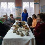 Bibliotekininkė Elena žemaitiškai sveikina susirinkusiuosius
